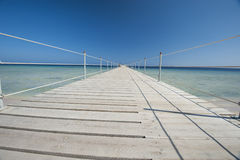 Wooden jetty on tropical beach Stock Photo
