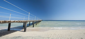 Wooden jetty on tropical beach Royalty Free Stock Photos
