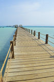 Wooden jetty on a tropical island beach Royalty Free Stock Photo