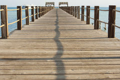 Wooden jetty on a tropical island Stock Photos