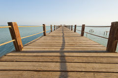 Wooden jetty on a tropical island Stock Images