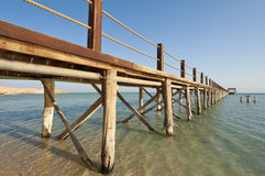 Wooden jetty on a tropical island Stock Photo