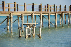 Wooden jetty on a tropical island Royalty Free Stock Images