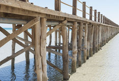 Wooden jetty in a tropical lagoon Royalty Free Stock Image