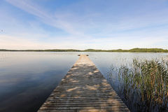 Wooden jetty on Ungurs lake in Latvia Stock Photos