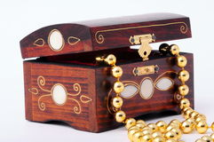Wooden jewel box. On white Royalty Free Stock Image