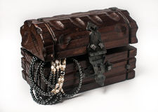 Wooden jewelery box packed with accessories Royalty Free Stock Images