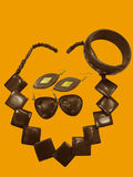 Wooden Jewelery Set. A wooden jewelry set containing two sets of earrings, a bangle and a necklace Stock Photography