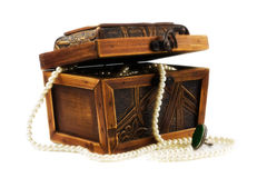 Wooden jewellery box packed with necklace Royalty Free Stock Photography