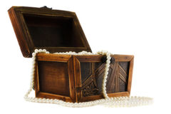 Wooden jewellery box packed with necklace Royalty Free Stock Image