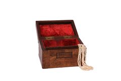 Wooden jewellery box with pearl necklace hanging out Royalty Free Stock Images