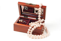Wooden jewelry box. With pearls jewelry inside Stock Photo