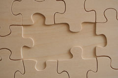 Wooden jigsaw. With two missed pieces borders royalty free stock photo