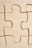 Wooden jigsaw close-up. Wooden jigsaw pattern close-up stock photo