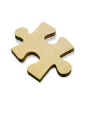 Wooden jigsaw piece. Close up of single wooden jigsaw piece, isolated on white background Stock Photos