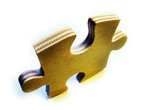 Wooden jigsaw piece Royalty Free Stock Photography