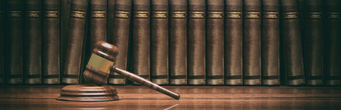 Wooden judge gavel and books. 3d illustration Stock Images