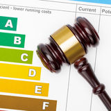 Wooden judge gavel and efficiency chart - close up Stock Photo