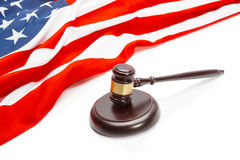 Wooden judge gavel near flag of Unites States of America - closeup shoot Royalty Free Stock Photography