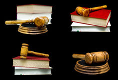 Wooden judge hammer and book on a black background. Stock Image