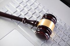 Wooden judge hammer on laptop computer Royalty Free Stock Photo