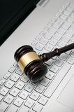 Wooden judge hammer on laptop computer Royalty Free Stock Image