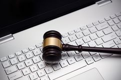Wooden judge hammer on laptop computer Stock Photo