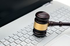 Wooden judge hammer on laptop computer white keyboard Stock Photography