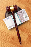 Wooden judge's gavel and money Stock Photo