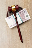 Wooden judge's gavel and money Stock Images