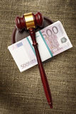 Wooden judge's gavel and money Royalty Free Stock Images