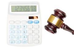 Wooden judge's gavel near calculator - close up studio shot Stock Photography