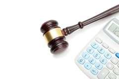 Wooden judge's gavel and neat calculator next to it Royalty Free Stock Photography