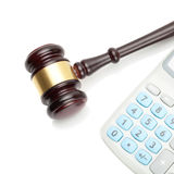 Wooden judge's gavel and neat calculator next to it - close up shot Stock Image