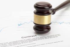 Wooden judge's gavel over contract - close up studio shot Stock Photo