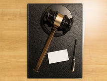 Wooden judges gavel and business cards on the wooden background stock photos
