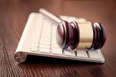 Wooden judges gavel on a computer keyboard Royalty Free Stock Images