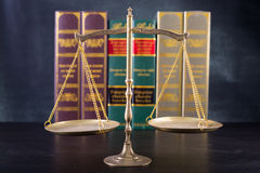 Wooden Judges gavel ,golden scales justice Stock Images