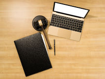 Wooden judges gavel and laptop on the wooden background Royalty Free Stock Photos