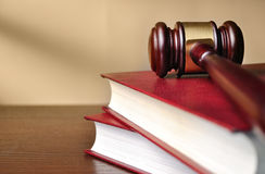 Wooden judges gavel on a law book Stock Photos