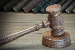 Wooden Judges Gavel And Old Law Books On Wooden Background Royalty Free Stock Photos