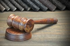 Wooden Judges Gavel And Old Law Books On Wooden Background Stock Image