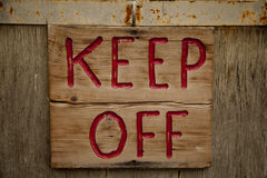Wooden Keep Off Sign Royalty Free Stock Photography
