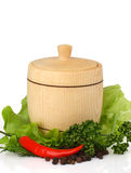 Wooden keg on fresh herbs with spices Royalty Free Stock Photo