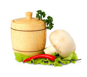 Wooden keg with peper and mushroom isolated on wh Stock Photography