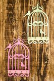 Wooden Key Hangers with Bird Cage Shape on Wooden Background Royalty Free Stock Images