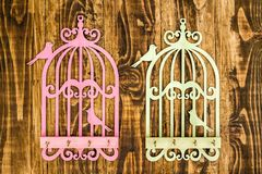 Wooden Key Hangers with Bird Cage Shape on Wooden Background Stock Images