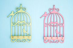 Wooden Key Hangers with Bird Cage Shape on Blue Wooden Backgroun Royalty Free Stock Images
