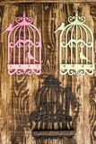 Wooden Key Hangers with Bird Cage Shape on Wooden Background Royalty Free Stock Photo