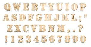 Wooden keyboard alphabet isolated. Letters, numbers and signs from the keyboard with wood style texture Stock Photo